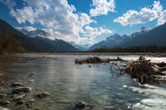 Flat water of rural river with stones Royalty Free Stock Images