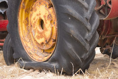 Flat wheel of broken farm tractor machine Royalty Free Stock Images