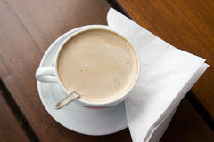 Flat white coffee on table Royalty Free Stock Images