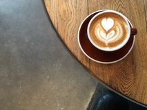 Flat white latte art on a wooden table from above Royalty Free Stock Photos