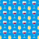 Flat white and red wine glasses seamless pattern. Vector colored flat design white and red wine glasses seamless pattern on blue background Royalty Free Stock Images