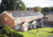 A flat the window with water drops on the windows. A flat with window and water drops on the windows House on the mortgage concept HD Monochromatic Rain Water Royalty Free Stock Photo