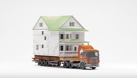 A flatbed articulated lorry loaded with a house isolated on a white background. Both are models. Good image for moving home themes