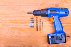 Flatbed of convenient cordless drill cum screwdriver set with bi Stock Images
