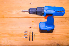 Flatbed of convenient cordless drill cum screwdriver set with bi Stock Image