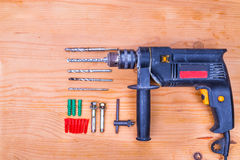 Flatbed of impact drilling set with bits and wall plugs Stock Photography