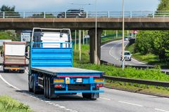 Flatbed lorry truck on uk motorway in fast motion.  royalty free stock images