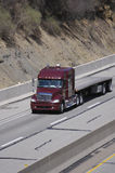 Flatbed Semi Truck. On the Highway Stock Photo