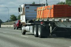 Flatbed semi truck with cargo Stock Photo