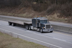 Flatbed Semi Truck on the Highway Stock Image