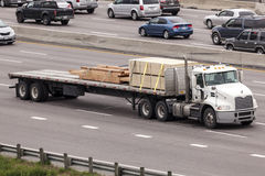 Free Flatbed Semitrailer Truck On The Highway Royalty Free Stock Image - 73099206