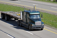 Flatbed Truck. Flat Bed Semi Truck on the Highway Stock Image
