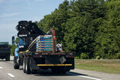 Flatbed Truck Freight. Flatbed truck with cargo on highway Stock Image