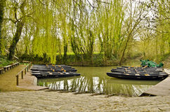 Flatboat jetty in the green Venice of Marais Poitevin. Flatboat and canoe jetty in the Green Venice of Marais Poitevin in Maillezais,  Vendee department, Pays de Royalty Free Stock Photo