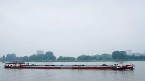 A flatboat on the river. A flatboat on the river Schelde in Antwerp, Belgium, June 2018 Stock Photography