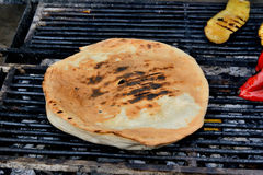 Flatbread cooked on the grill Stock Photos