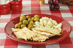 Flatbread crackers with feta cheese and olives Stock Images