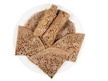 Flatbread etíope tradicional de la harina fermentada del teff en un w fotos de archivo