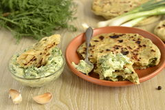Flatbread with greens and cucumber sauce Royalty Free Stock Photography