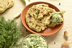 Flatbread with greens and cucumber sauce Stock Photo