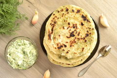 Flatbread with greens and cucumber sauce Stock Image