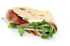 Flatbread with ham and cheese. Close up of italian typical sandwich with ham on white background stock images