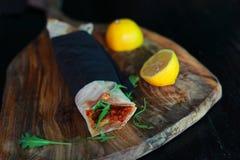 Flatbread lahmacun turkish pizza with mincedmeat, arugula, lemon Stock Images