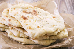 Flatbread on parchment paper Stock Image