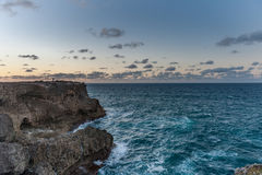 FLATFIELD, BARBADOS - MARCH 18, 2014: Man Photograph Sunset Landscape in Barbados, Next To Animal Flower Cave Royalty Free Stock Image