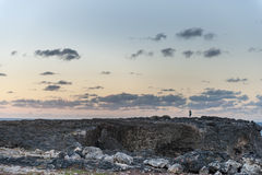 FLATFIELD, BARBADOS - MARCH 18, 2014: Man Photograph Sunset Landscape in Barbados, Next To Animal Flower Cave Royalty Free Stock Photography