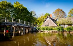 Flatford, Dedham Vale, Suffolk, England. A footbridge over the River Stour in the heart of the Suffolk countryside known as Constable Country due to its links Stock Image