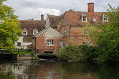 Flatford Mill. Is a Grade I listed 18th century watermill built in 1733 in Flatford, East Bergholt, Suffolk, England. Attached to the mill is a 17th-century Royalty Free Stock Photo