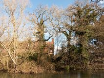 Flatford mill house spring from across the lake on side river stour constable country close up. Essex; england; uk Royalty Free Stock Photos