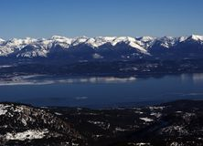 Flathead Lake in the winter. Flathead Lake and the Swan Mountain Range in the winter Royalty Free Stock Photo
