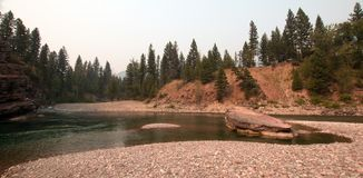 Flathead and Spotted Bear Rivers meeting point in the Bob Marshall wilderness area during the 2017 fall fires in Montana USA. Confluence where the Flathead and Stock Photos