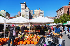 Flatiron Building in Manhattan, New York City. New York City, USA - October 10, 2015: farmers market on Union Square, NYC, with unidentified people. Union Square Stock Photography