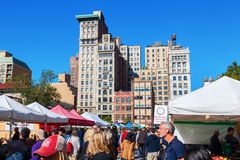 Flatiron Building in Manhattan, New York City. New York City, USA - October 10, 2015: farmers market on Union Square, NYC, with unidentified people. Union Square Stock Image