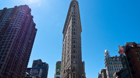 Flatiron building, New York city. Flatiron building, originally called the Fuller building, on a bright summer day, as seen from Madison Suare Park, New York Royalty Free Stock Images