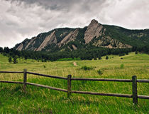 Flatiron Mountain range in Boulder, Colorado. Storm clouds over the Flatiron rock formations, part of the Rocky Mountain foothills just outside Boulder, Colorado Stock Photos
