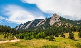 The Flatirons in Boulder, Colorado on a sunny summer day. Landscape featuring the Flatirons in Boulder Colorado and the surrounding scenery Stock Photos