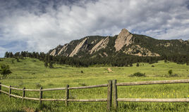 Flatirons hiking trail. Wooden fence along field near Flatirons hiking trail, Boulder, Colorado Stock Image