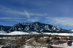 Flatirons Mountains in Boulder, Colorado on a Cold Snowy Winter. Day Royalty Free Stock Photo