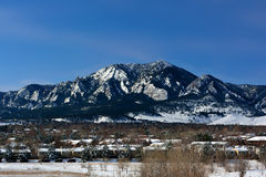 Flatirons Mountains in Boulder, Colorado on a Cold Snowy Winter Royalty Free Stock Photos