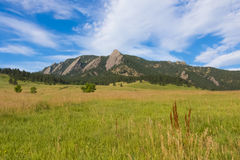 Flatirons Mountains in Boulder, Colorado. This picture was taken during a shiny morning in Chautauqua Park, and edited using Photoshop software Royalty Free Stock Photo
