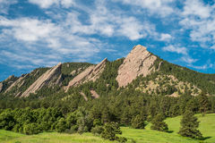 Flatirons on a Sunny Day. Photograph of the Flatirons rock formation on a sunny summer day in Boulder, Colorado Stock Photography