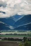Flatlands and mountains. The difference between the flat farm lands and the mountains stock image