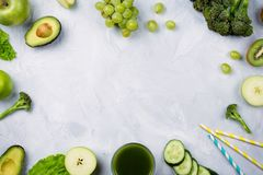 Flatlay arrangement with various green fruits and vegetables: lettuce, cucumber, avocado, broccoli, grapes, apples etc. Frame flatlay arrangement with various royalty free stock image