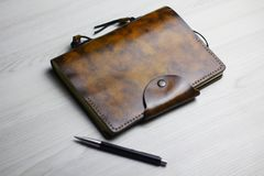 Flatlay of the beautiful leather notebook on the light background stock photography