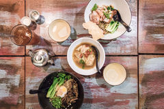 Flatlay of Chinese wanton dumpling noodle dishes. Flatlay of Chinese roasted pork charsiew wanton mee dumpling noodles dishes in a Singaporean restaurant, with Royalty Free Stock Photos