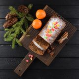 Flatlay of chocolate fruit cake decorated with sugar icing, cand